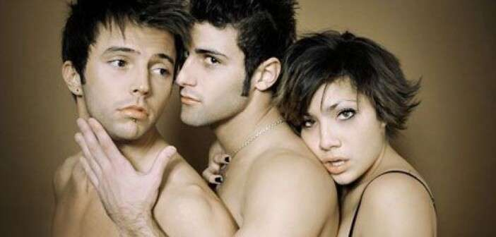 two men and one woman cuddling into each others backs