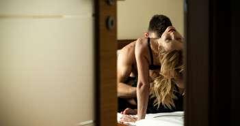 Couple seen through a door opening