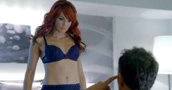 Sexbot in blue lingerie being looked at by a male sitting down